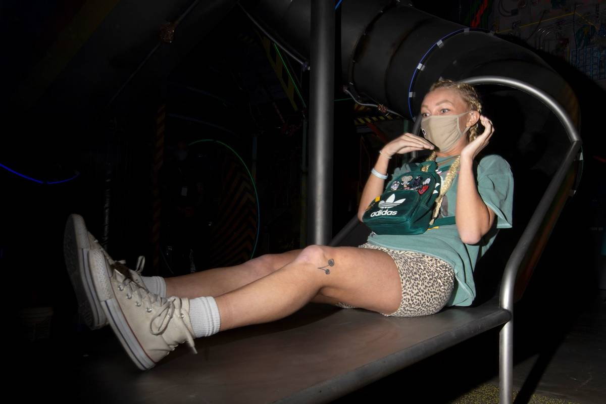 Allie Thompson, of Pennsylvania, reacts to one of the slides at the Omega Mart at Area15 on Thu ...