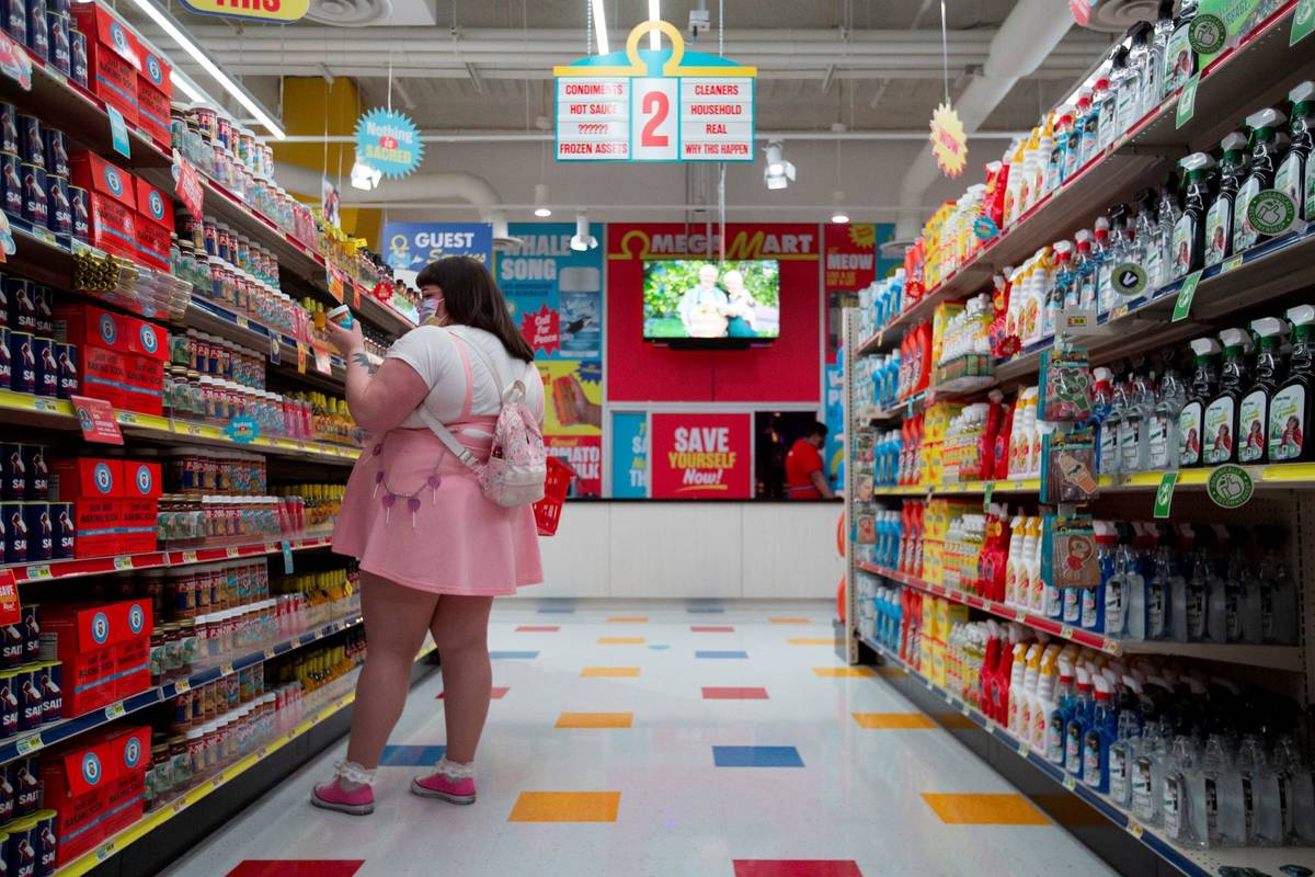 Customers browse the shelves on opening day at the Omega Mart at Area15 on Thursday, Feb. 18, 2 ...