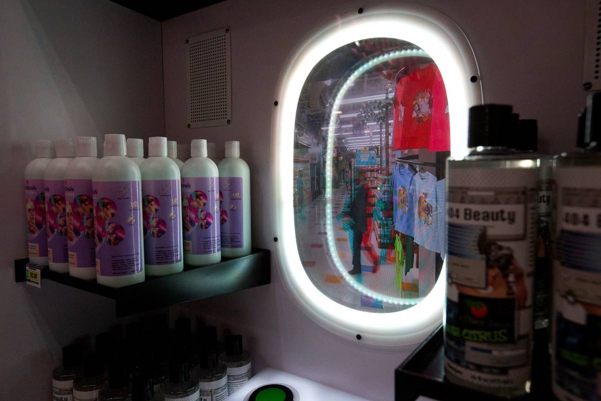 A beauty mirror allows customers to view themselves in a different way inside the Omega Mart at ...