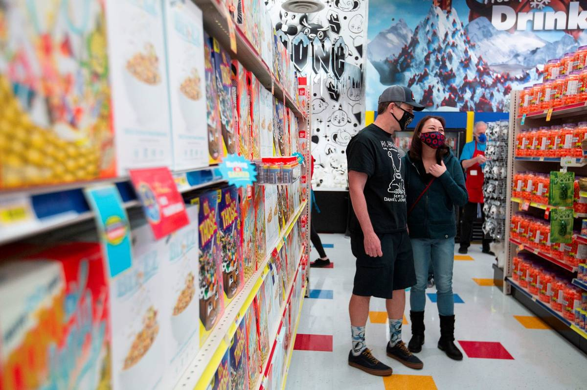 Brian Rogers and Sue Roh laugh at the comedically titled products for sale on opening day at th ...