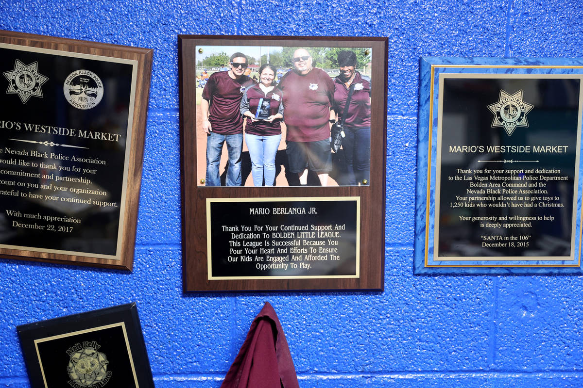 Youth baseball plaques in the office of Mario Berlanga, Jr., president of Mario's Westside Mark ...