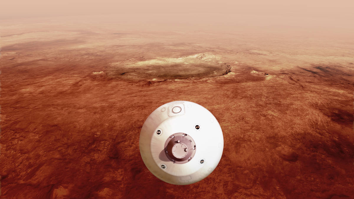 In this illustration made available by NASA, The aeroshell containing the Perseverance rover gu ...