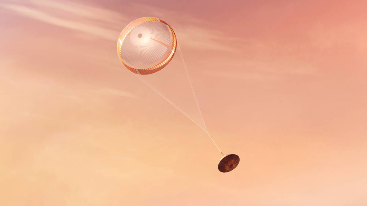 In this illustration made available by NASA, the Perseverance rover deploys a supersonic parach ...