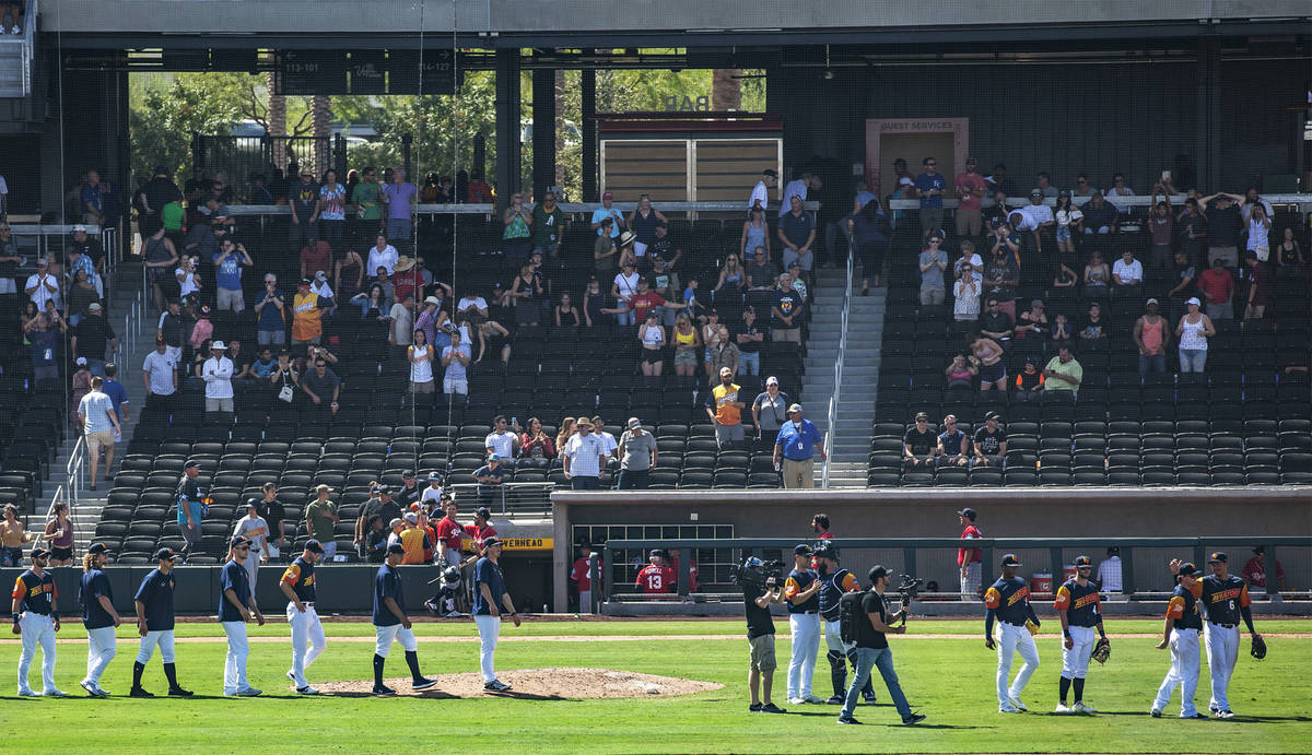 The Las Vegas Aviators walk the field after winning against the Tacoma Rainiers 3-2 in their fi ...