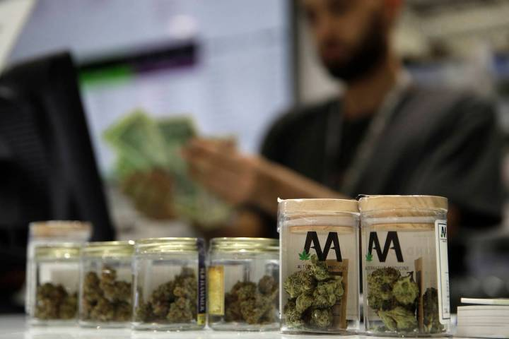 A cashier rings up a marijuana sale July 1, 2017, at the Essence cannabis dispensary in Las Veg ...