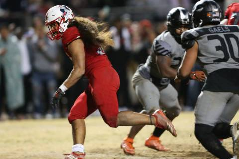 Liberty's Zyrus Fiaseu (30) rushes the ball for a touchdown to win in overtime as Bishop Gorman ...
