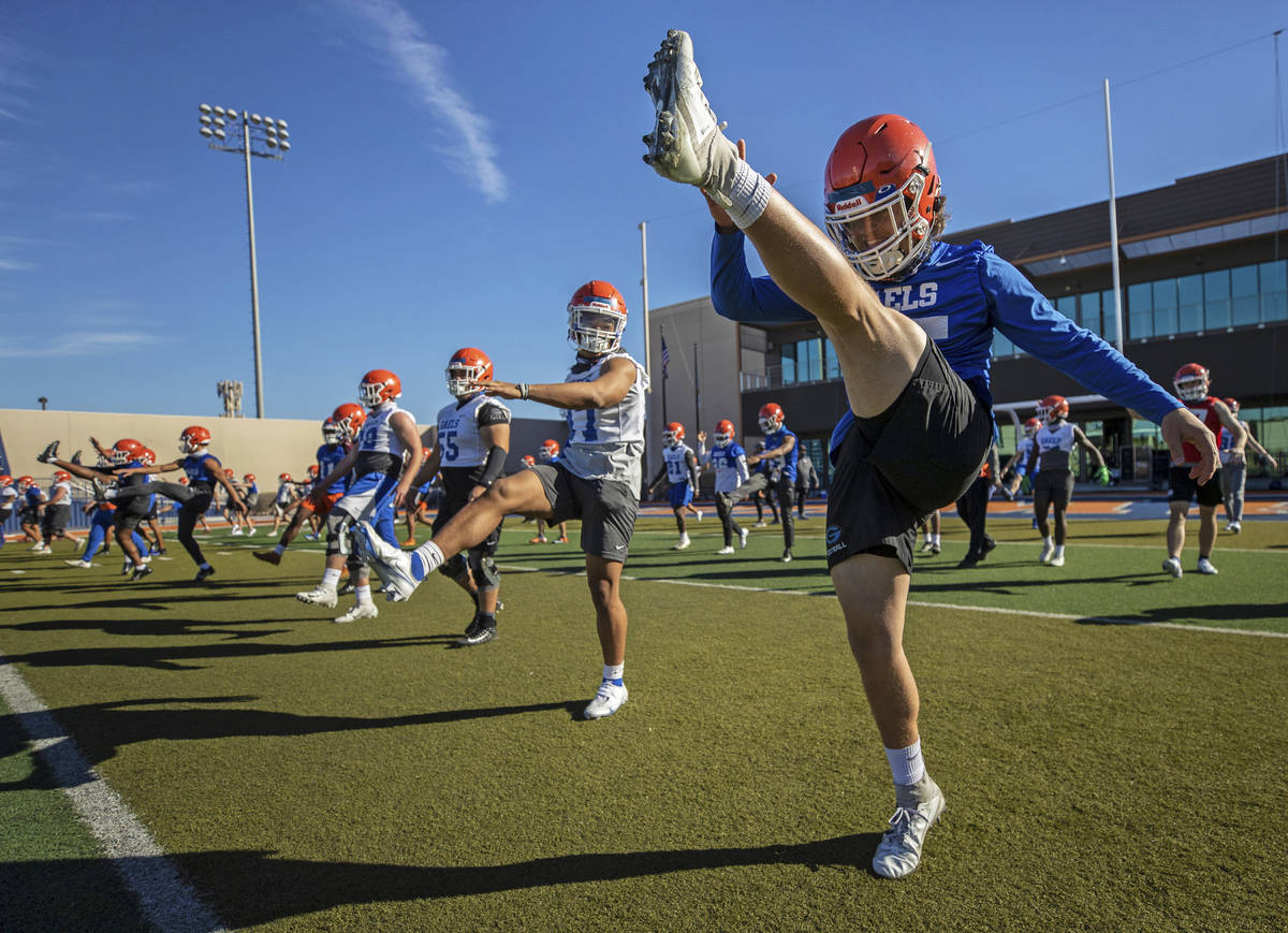 Bishop Gorman's D.J. Herman (25) leads stretching during practice on Friday, Feb. 19, 2021, at ...