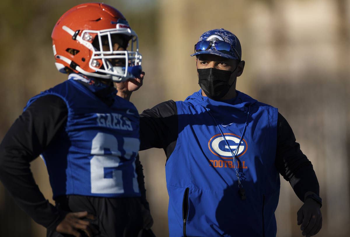 Bishop Gorman head football coach Brent Browner, right, leads practice on Friday, Feb. 19, 2021 ...