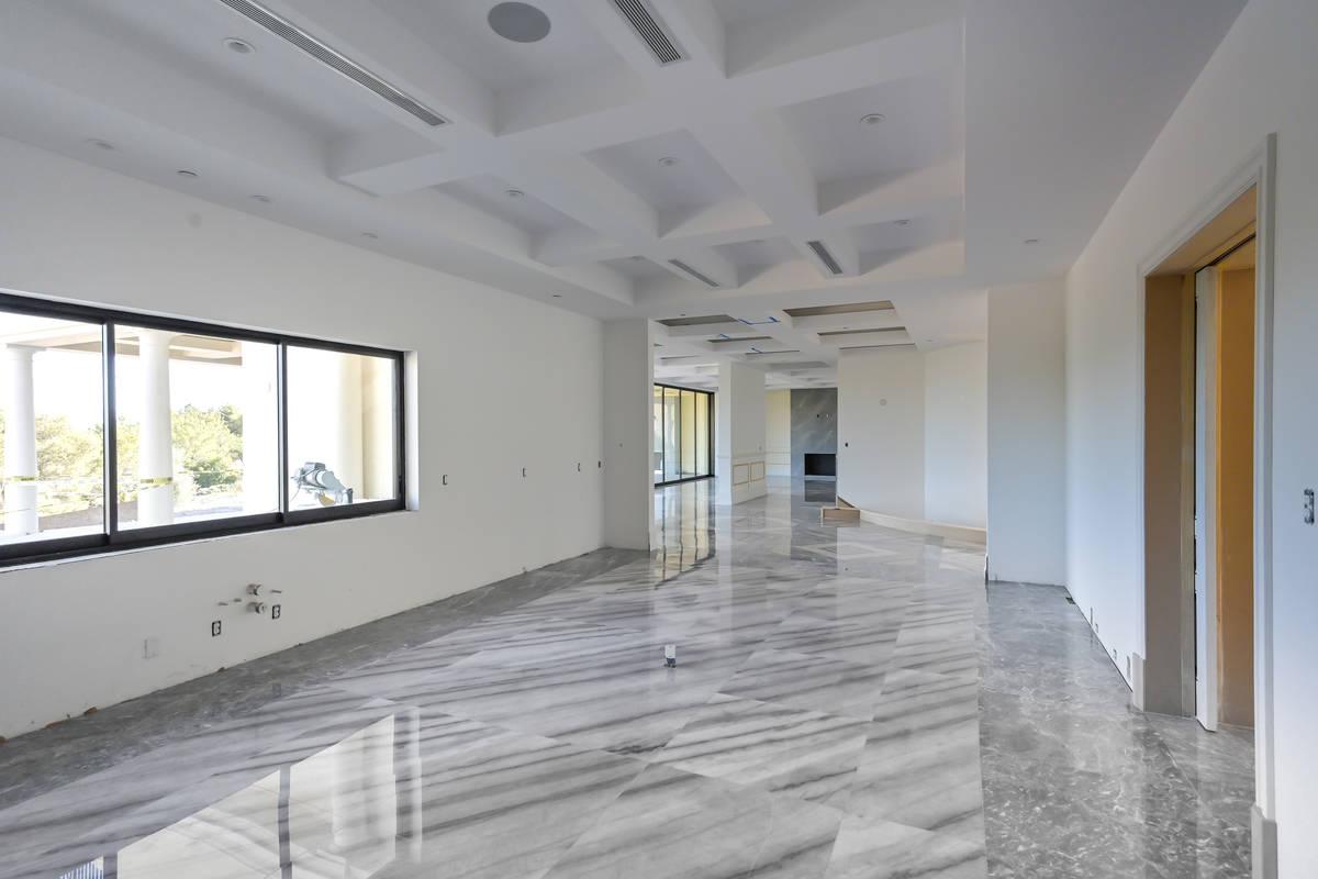 The main floor has a secondary master bedroom, office, living room, family room, formal dining ...