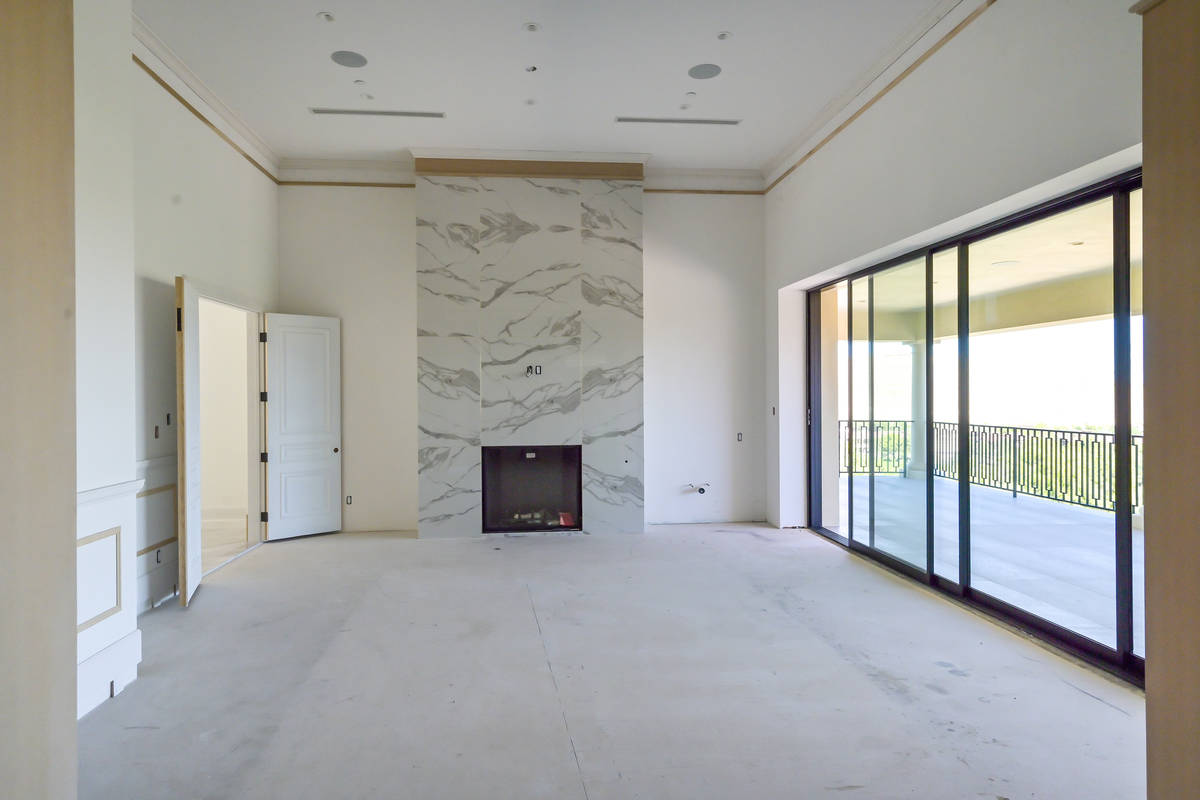 A fireplace is the center of the living room. (Luxurious Real Estate)