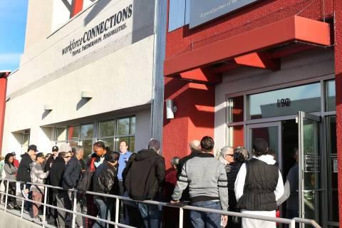 People wait in line at One-Stop Career Center in Las Vegas in March 2020. (Bizuayehu Tesfaye/La ...