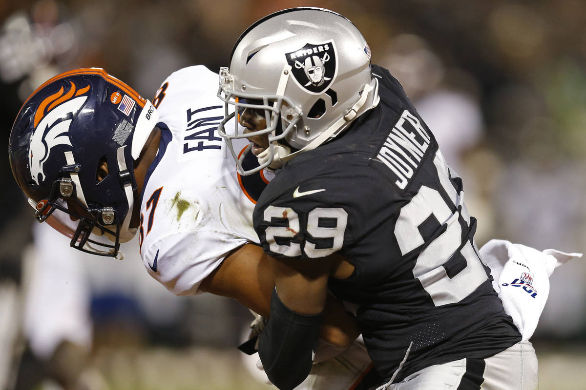 Denver Broncos tight end Noah Fant is stopped by Oakland Raiders free safety Lamarcus Joyner (2 ...