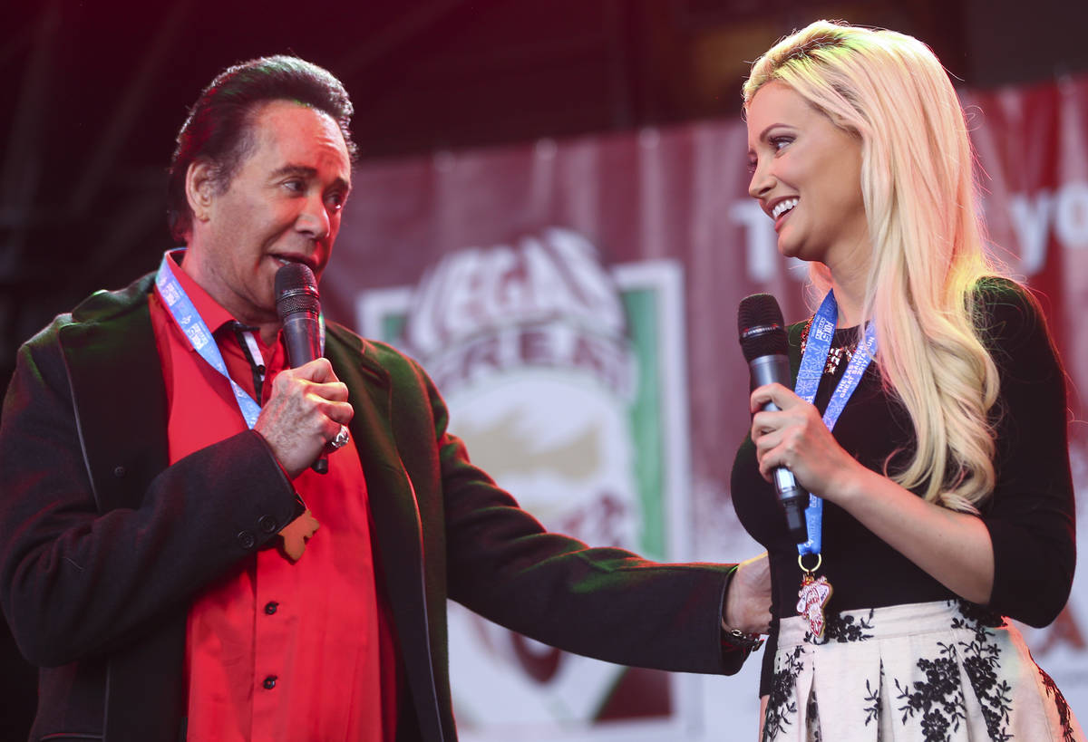 Wayne Newton and Holly Madison before the start of the Las Vegas Great Santa Run in downtown La ...