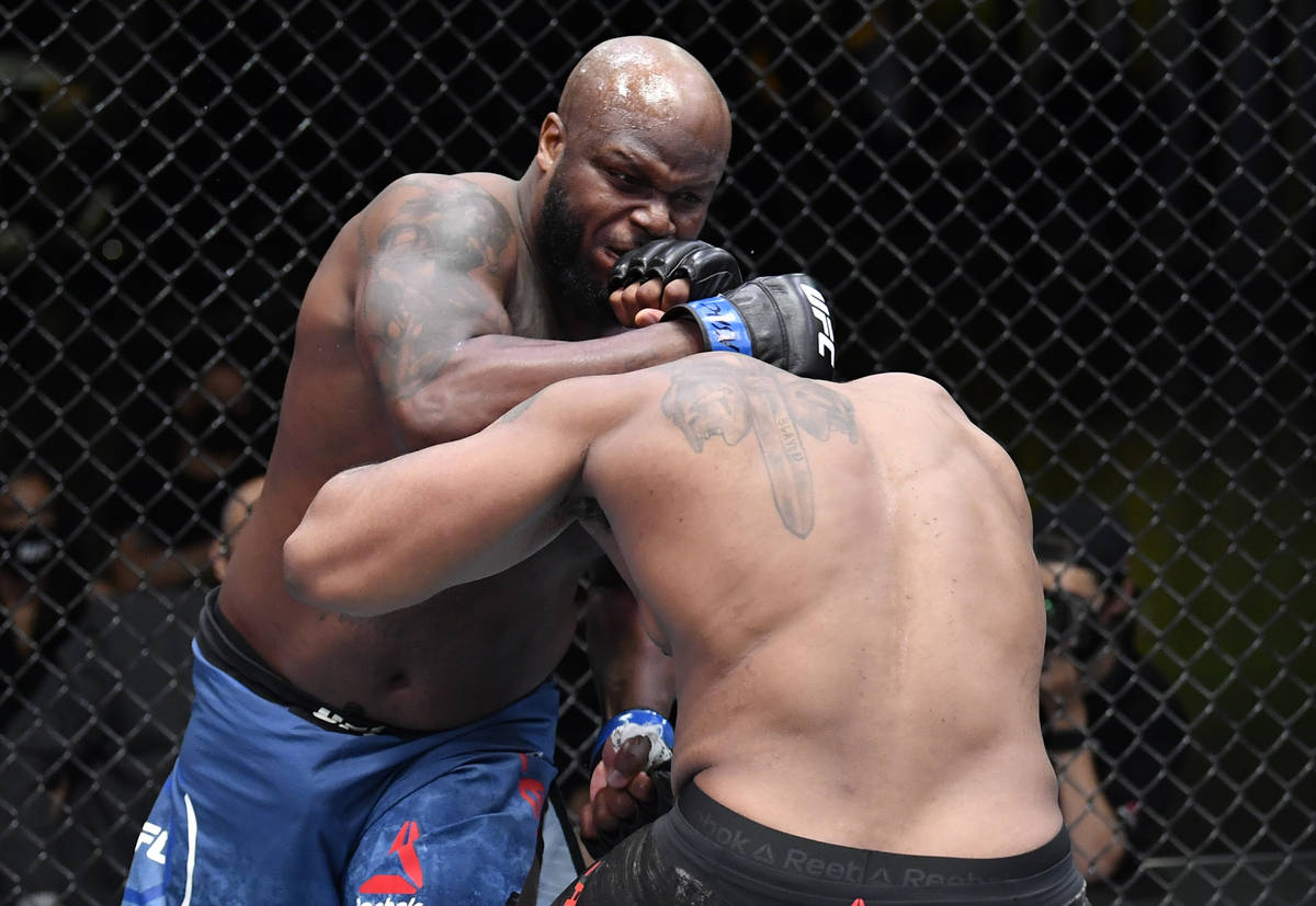 (L-R) Derrick Lewis punches Curtis Blaydes in a heavyweight bout during the UFC Fight Night eve ...