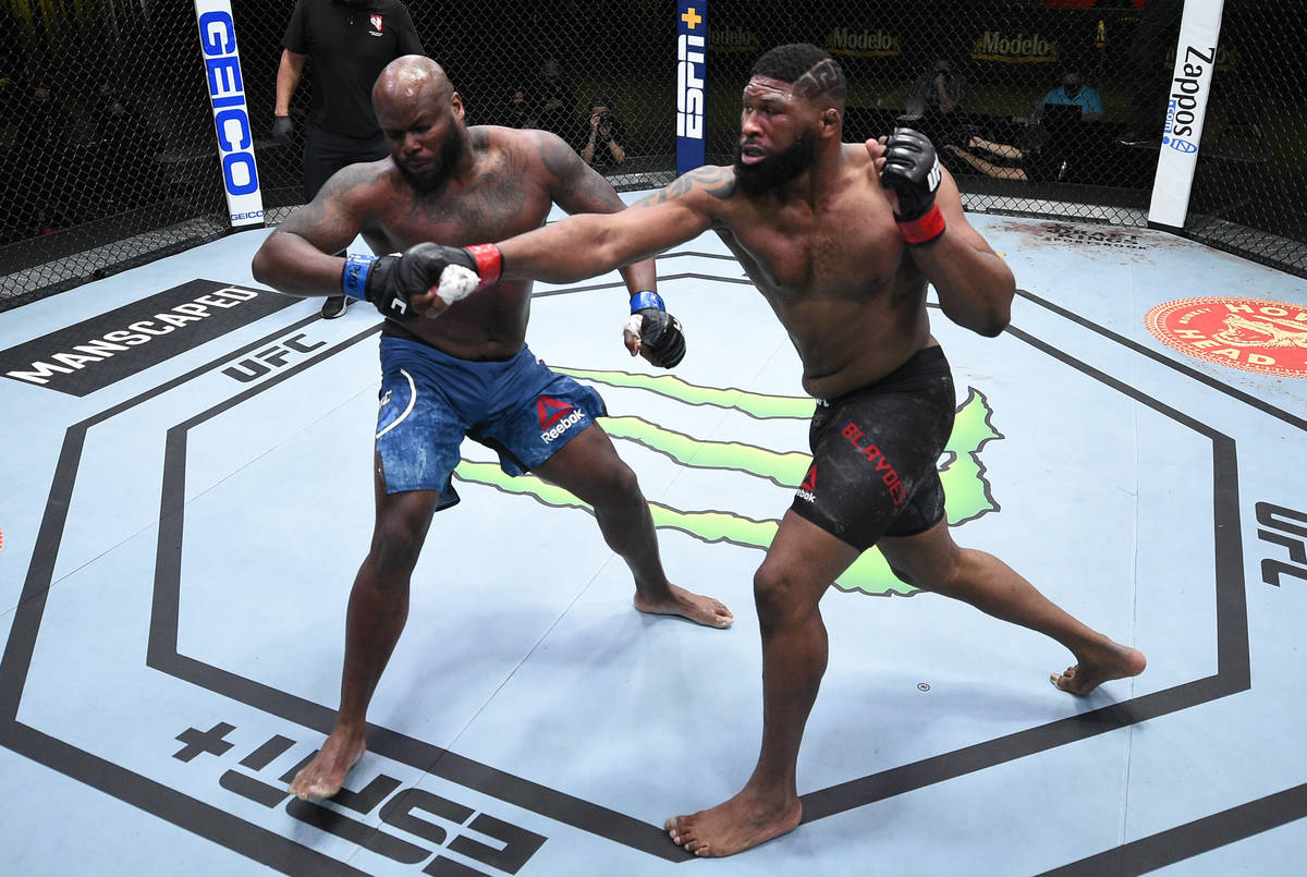 (R-L) Curtis Blaydes punches Derrick Lewis in a heavyweight bout during the UFC Fight Night eve ...