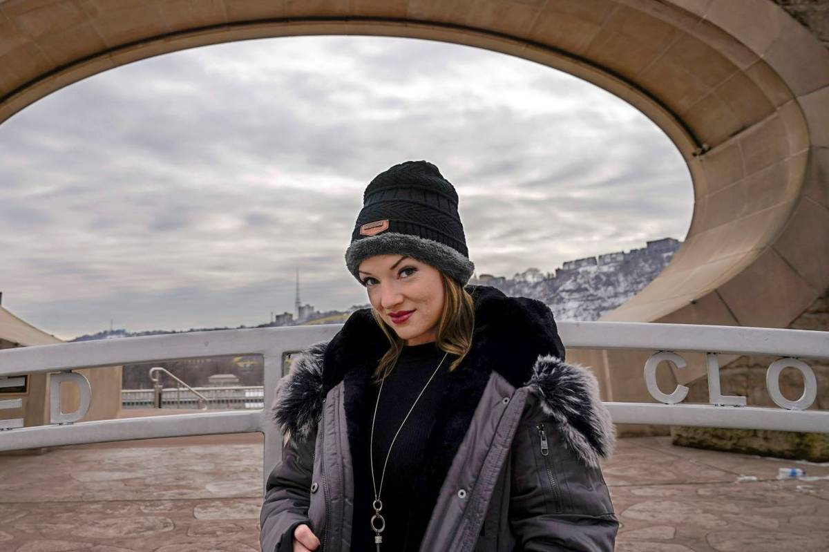Allissa Star poses for a photograph along the north shore of the Allegheny River in Pittsburgh ...