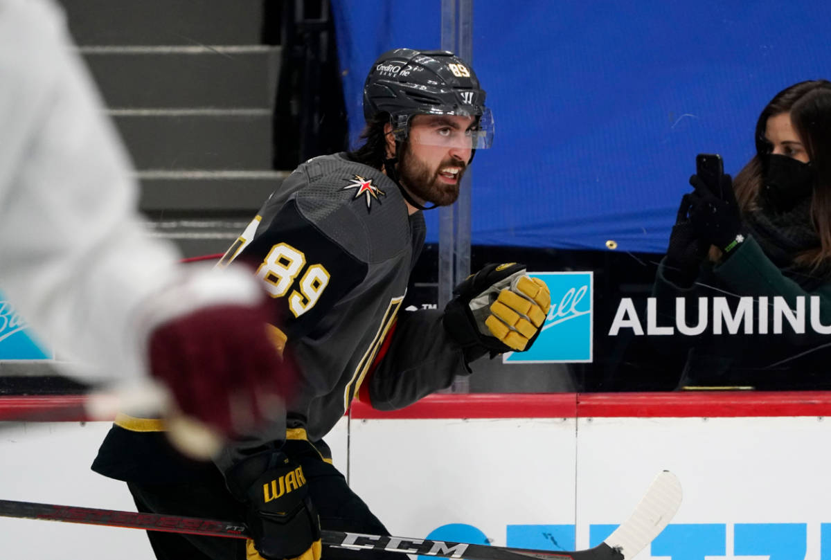 Vegas Golden Knights right wing Alex Tuch, back, reacts after scoring a goal against the Colora ...