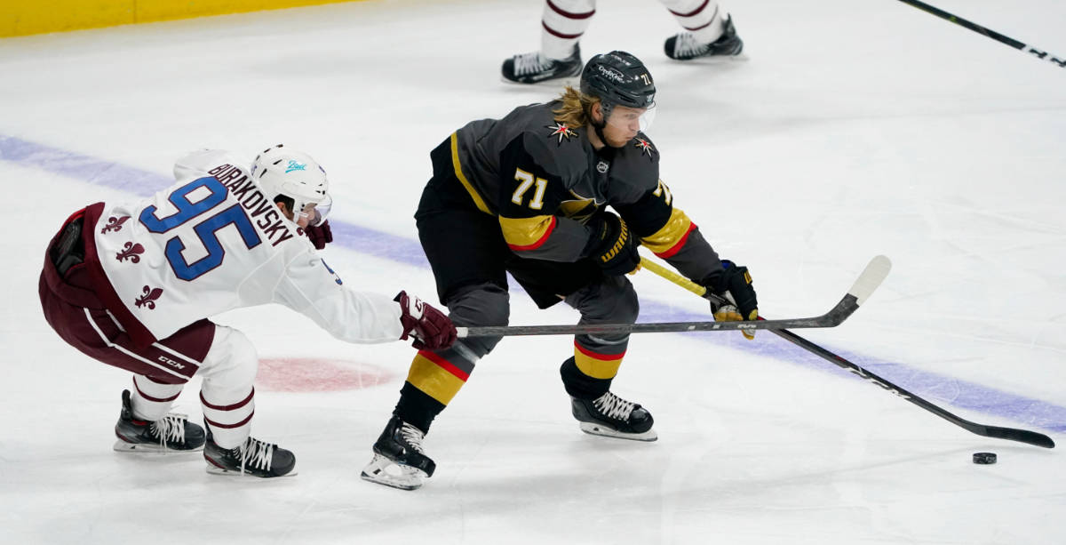 Vegas Golden Knights center William Karlsson, right, reaches out to control the puck as Colorad ...