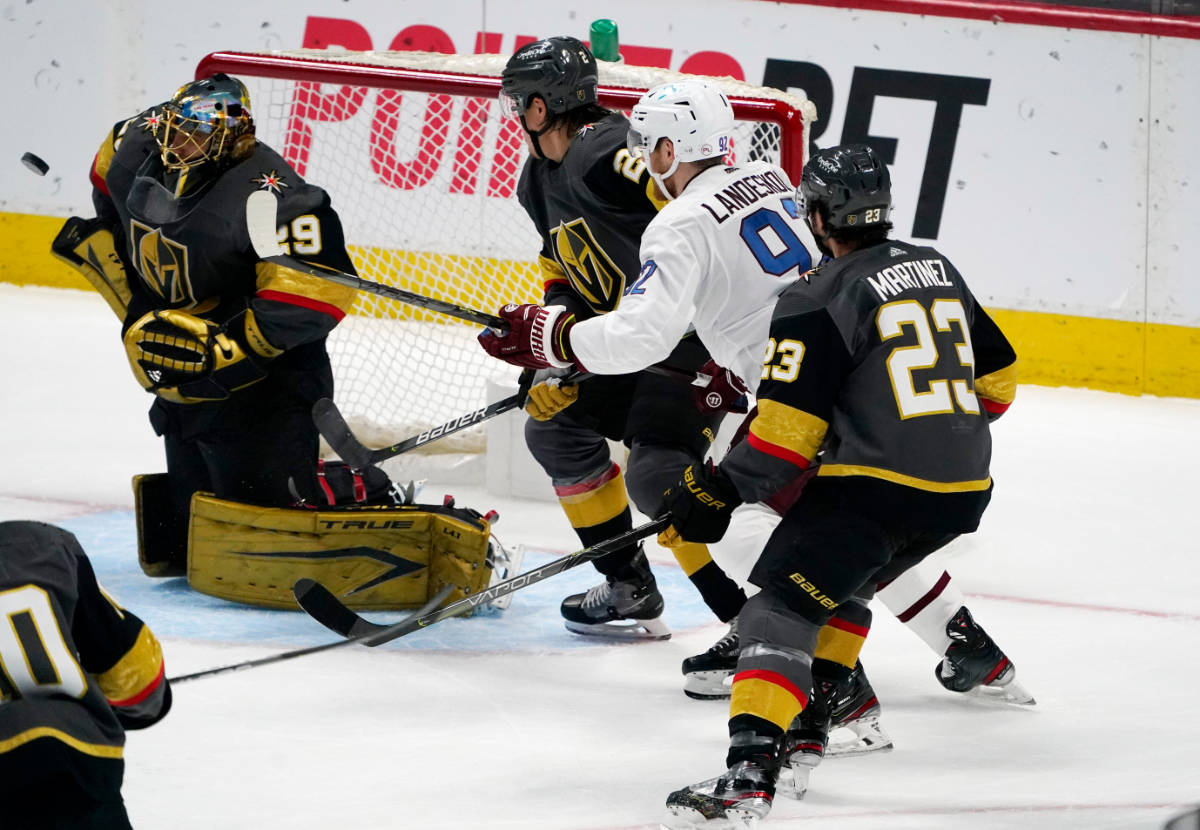 From left, Vegas Golden Knights goaltender Marc-Andre Fleury deflects a shot as defenseman Zach ...