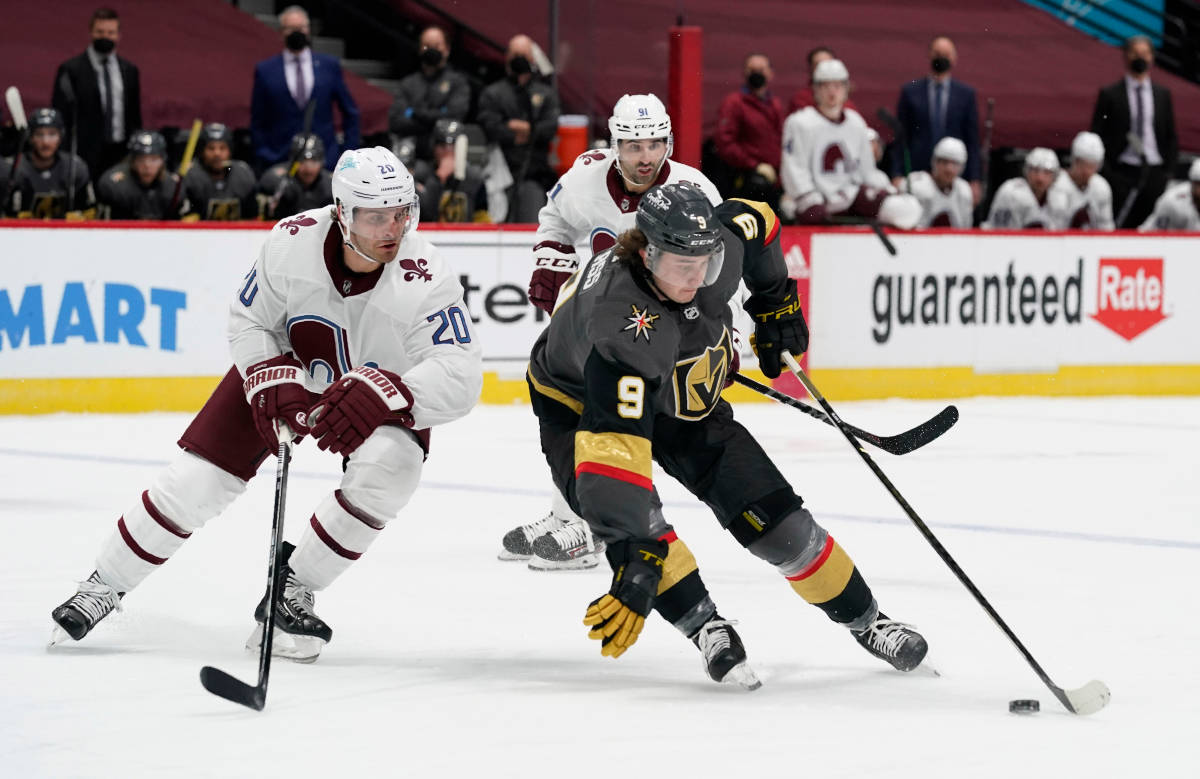 Vegas Golden Knights center Cody Glass, front right, picks up the puck as Colorado Avalanche le ...
