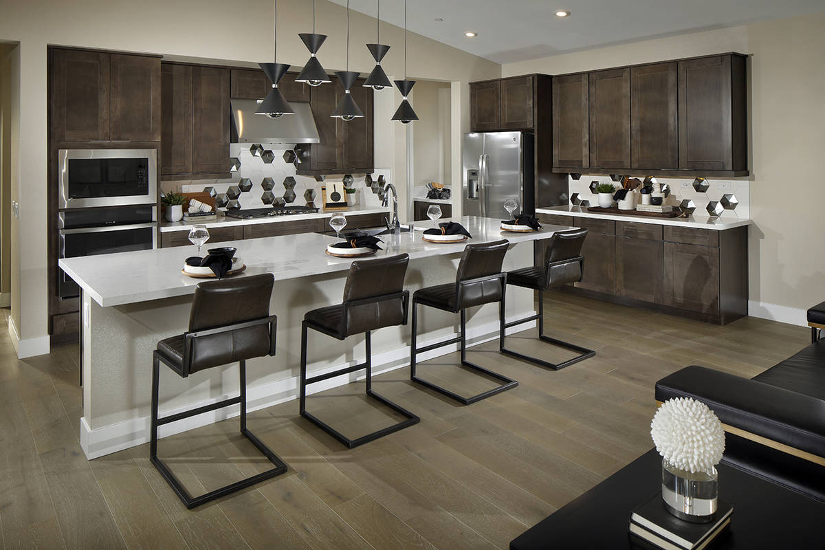 Strada in Inspirada, a Henderson master-planned community, features a kitchen with an island. T ...