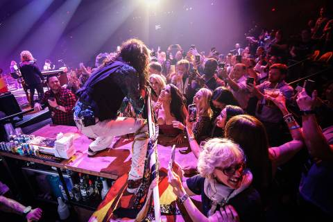 Steven Tyler of Aerosmith is shown performing on the bar in the onstage VIP section at Park The ...