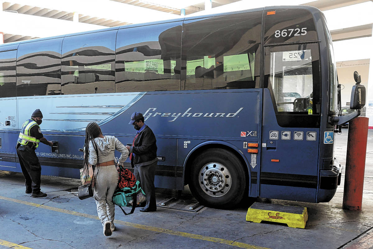 The final customer runs to catch the final bus leaving the Greyhound bus terminal on Main Stree ...
