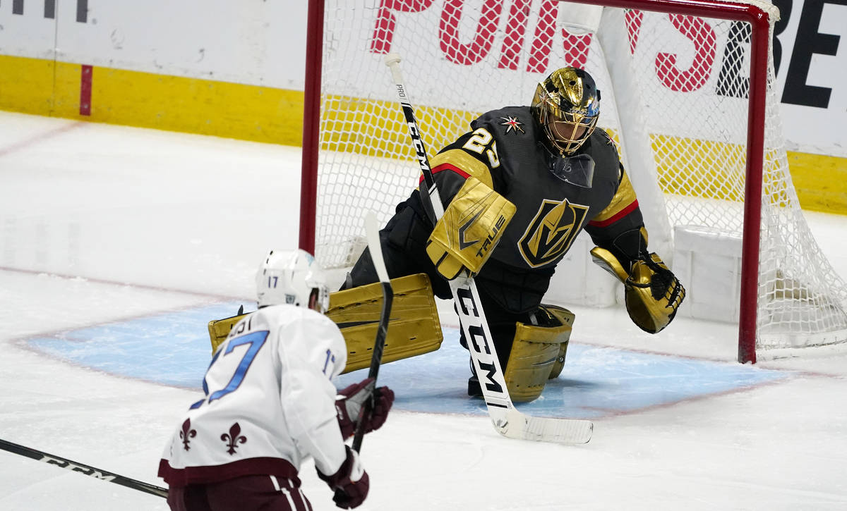 Vegas Golden Knights goaltender Marc-Andre Fleury, back, makes a stick save of a shot by Colora ...