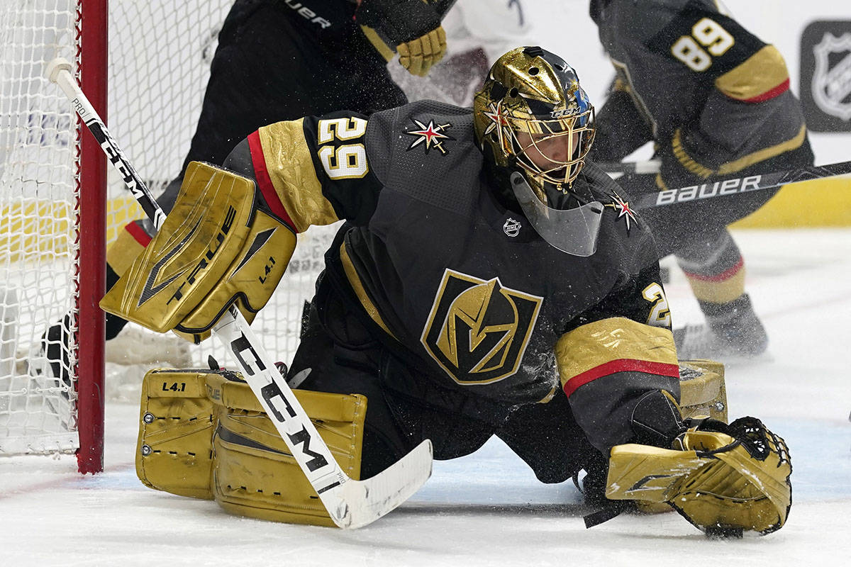 Vegas Golden Knights goaltender Marc-Andre Fleury makes a glove save of a shot against the Colo ...
