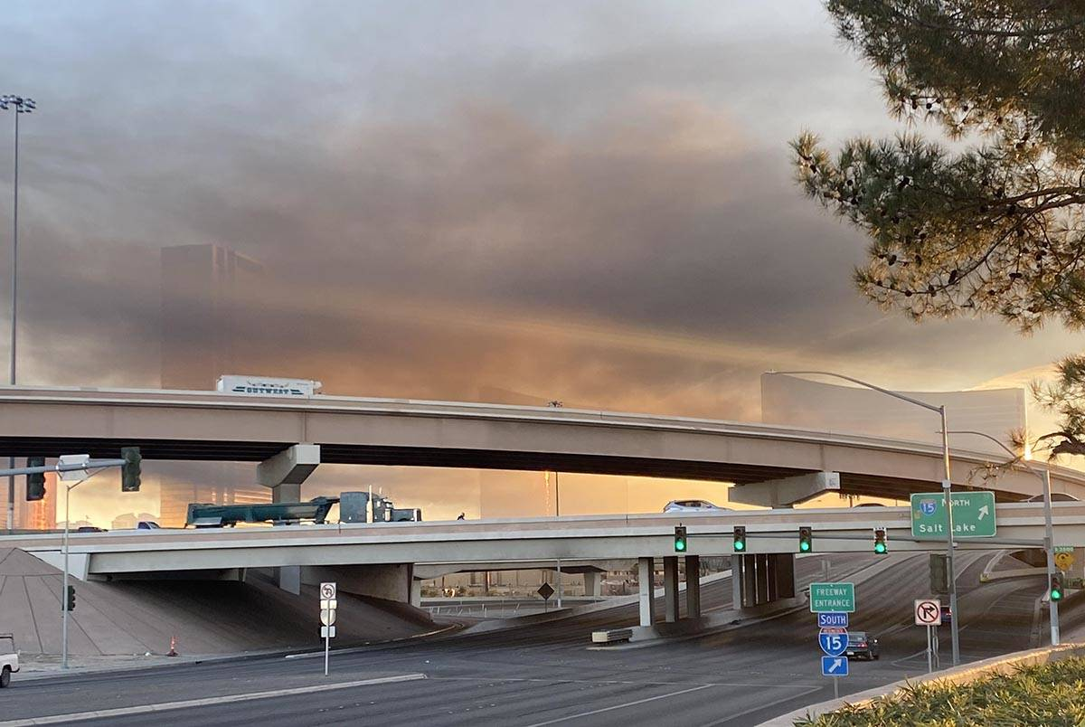 Smoke fills much of the sky near Interstate 15 and Flamingo Road early Tuesday, Feb. 23, 2021. ...