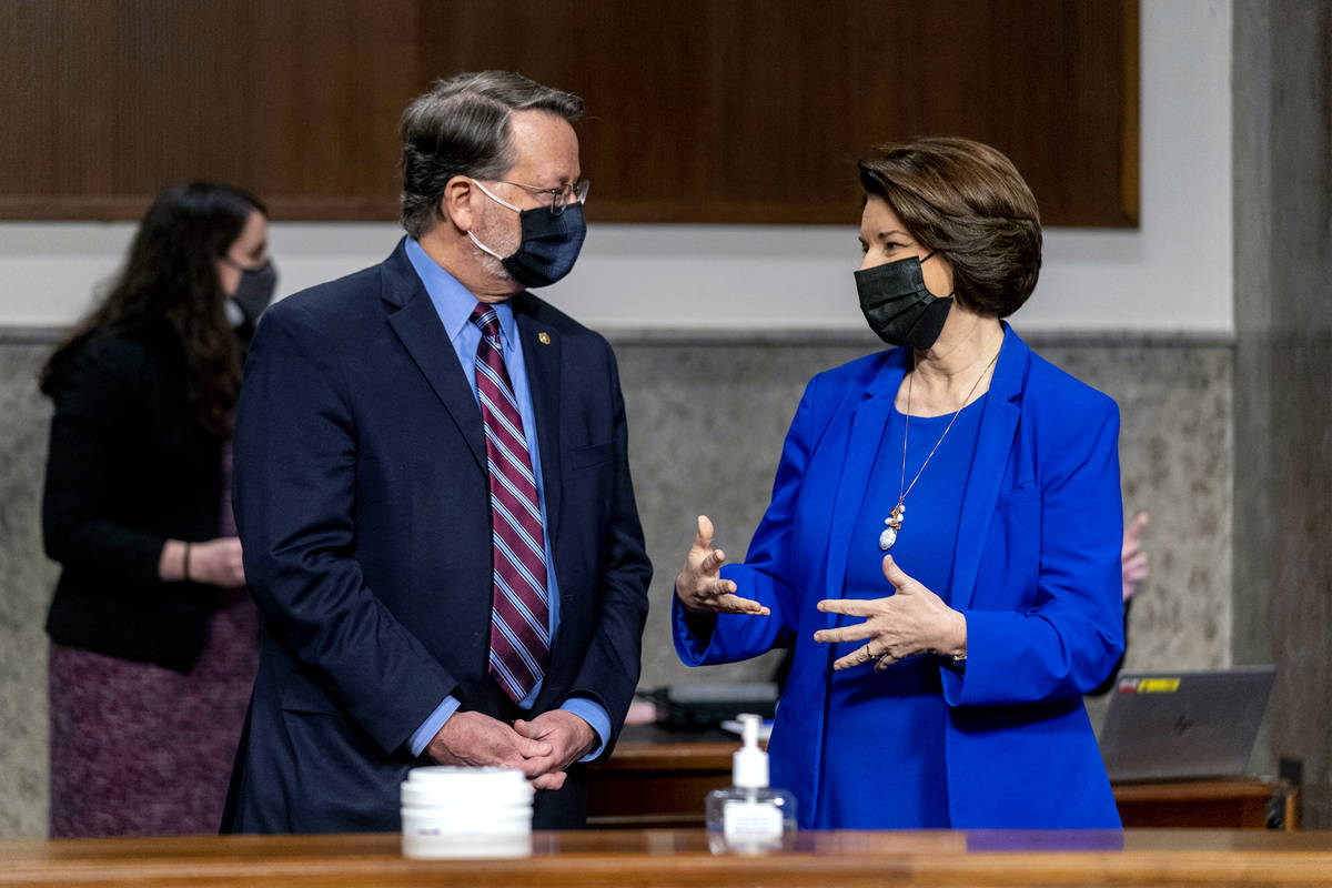 Chairman Sen. Gary Peters., D-Mich., left, and Chairwoman Amy Klobuchar, D-Minn., right, speak ...