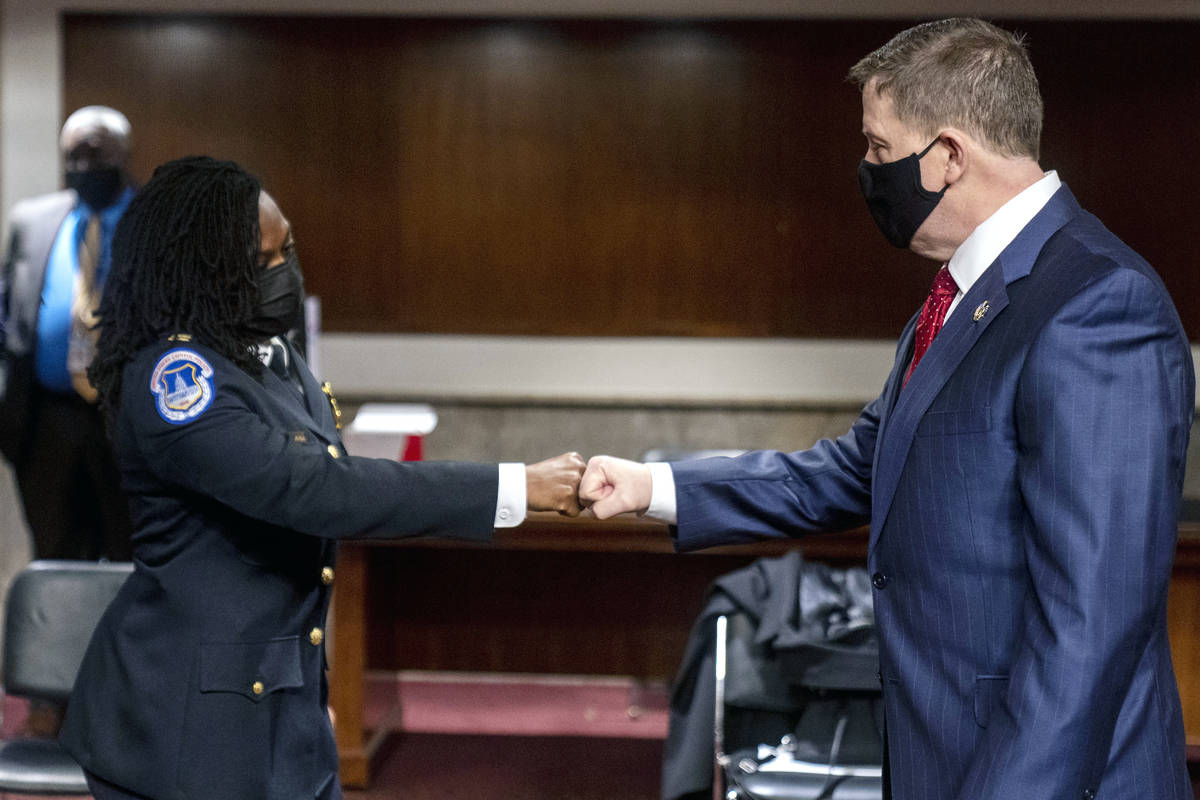 Former U.S. Capitol Police Chief Steven Sund, right, and Capitol Police Captain Carneysha Mendo ...