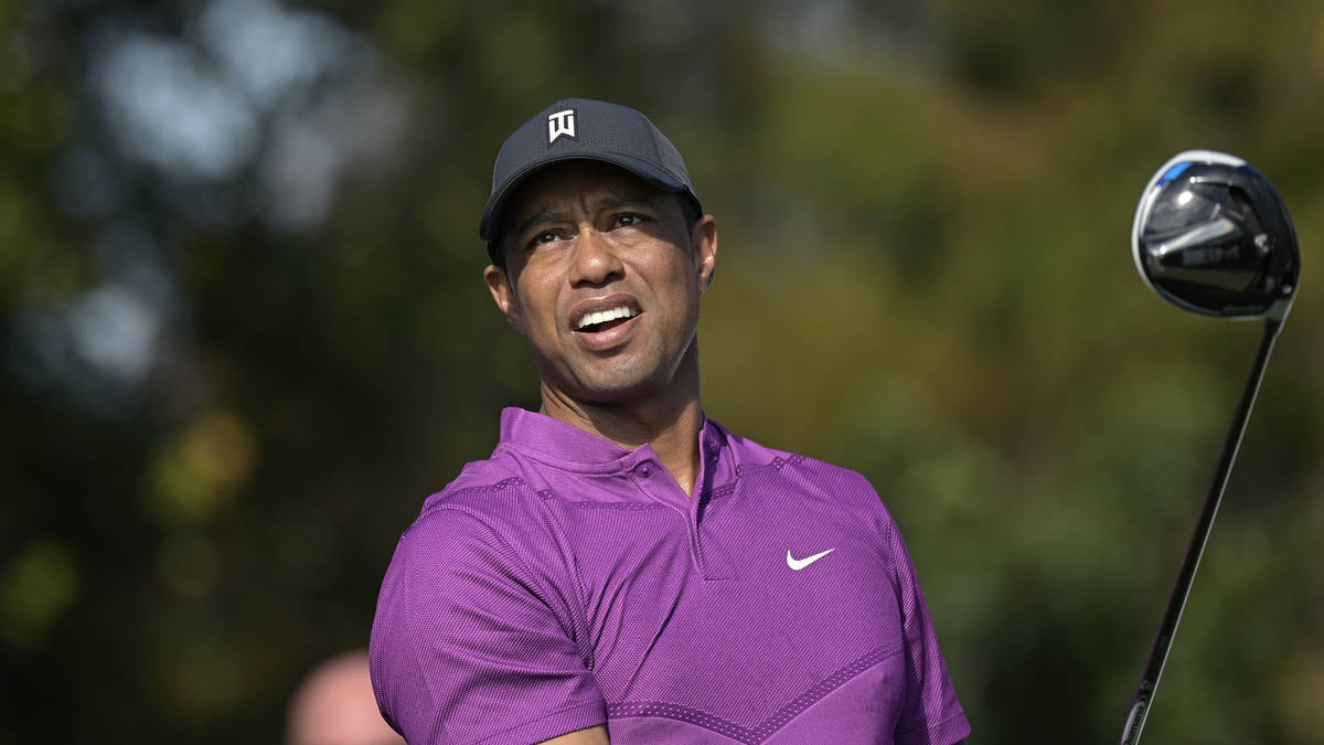 This Dec. 19, 2020, file photo shows Tiger Woods watching his tee shot on the first hole during ...