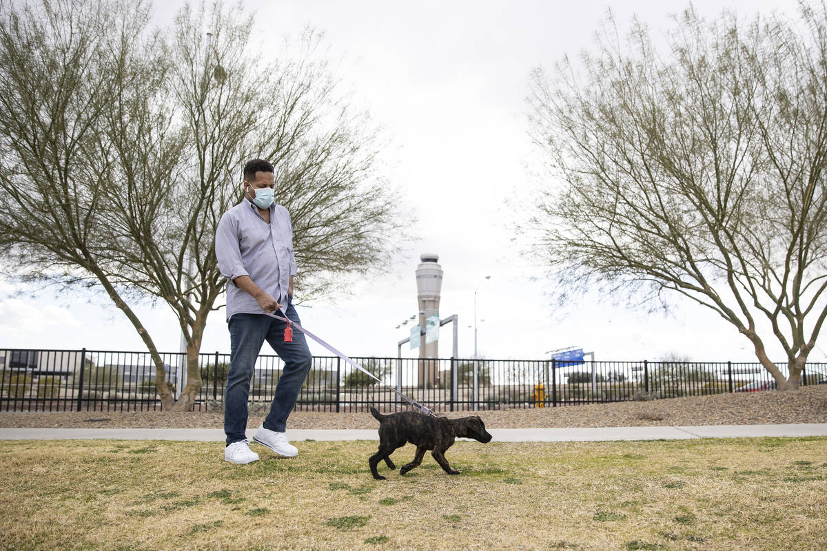 Ronald Pipkins, who was the first presumptive positive case of COVID-19 in Nevada, walks his do ...