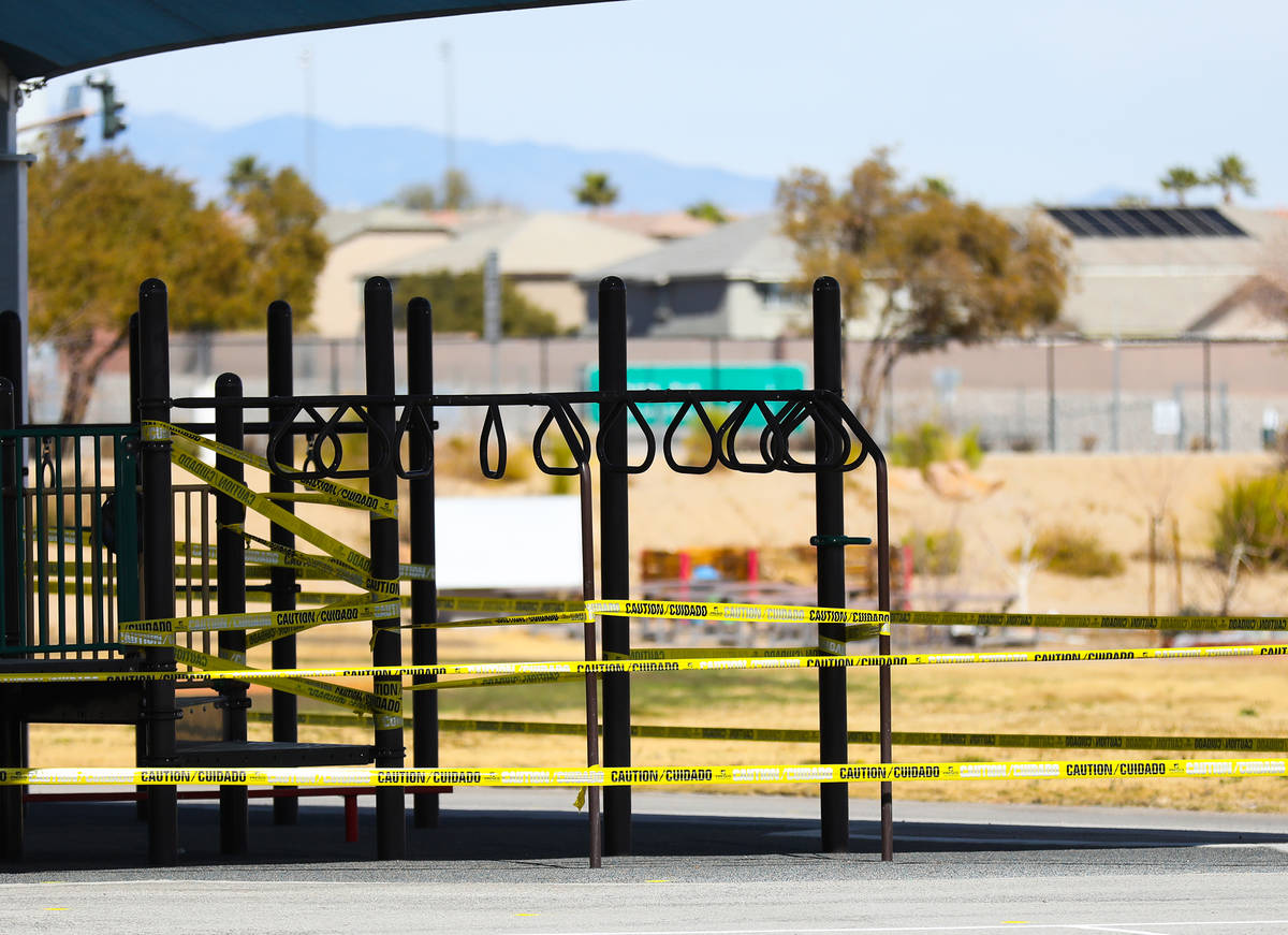 A playground is taped off at an event to showcase the hybrid instructional model for Pre-K to 3 ...
