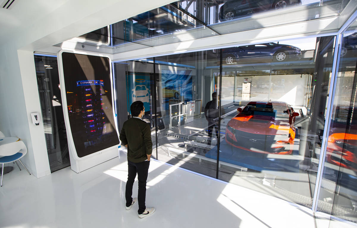 Bryce Bergevin, a vending machine specialist at Carvana, watches as a 2019 Chevrolet Camaro SS ...