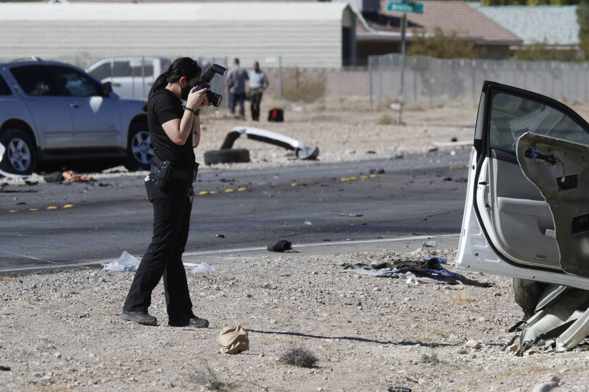 Las Vegas police investigate a crash at the intersection of Warm Springs Road and South Schirll ...