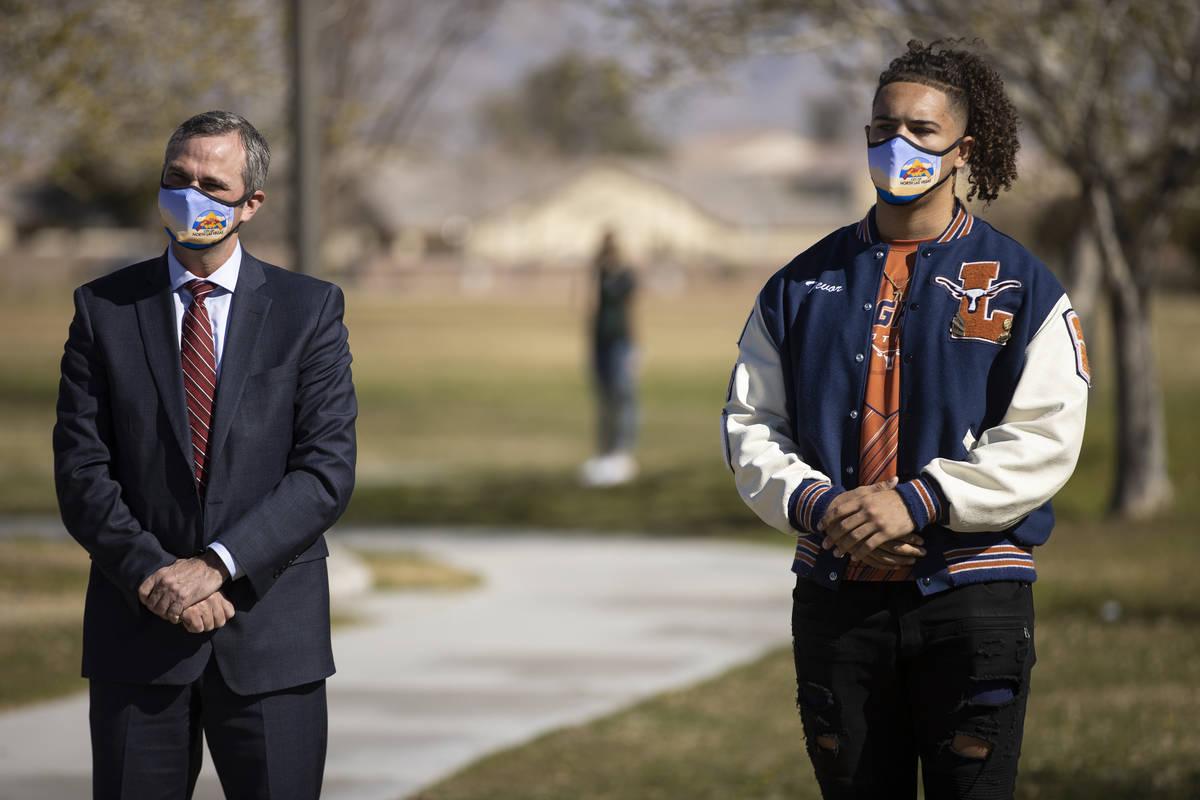 North Las Vegas City Manager Ryann Juden, left, and Trevor Moser, 17, a senior a Legacy High S ...