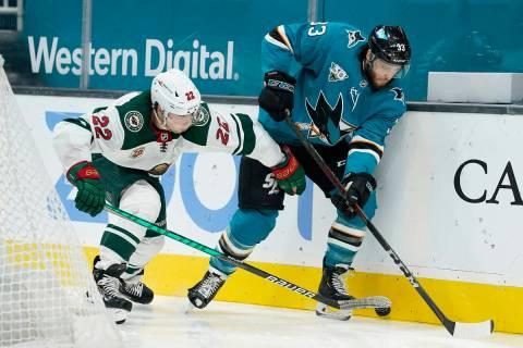 Minnesota Wild left wing Kevin Fiala (22) battles for the puck against San Jose Sharks defensem ...