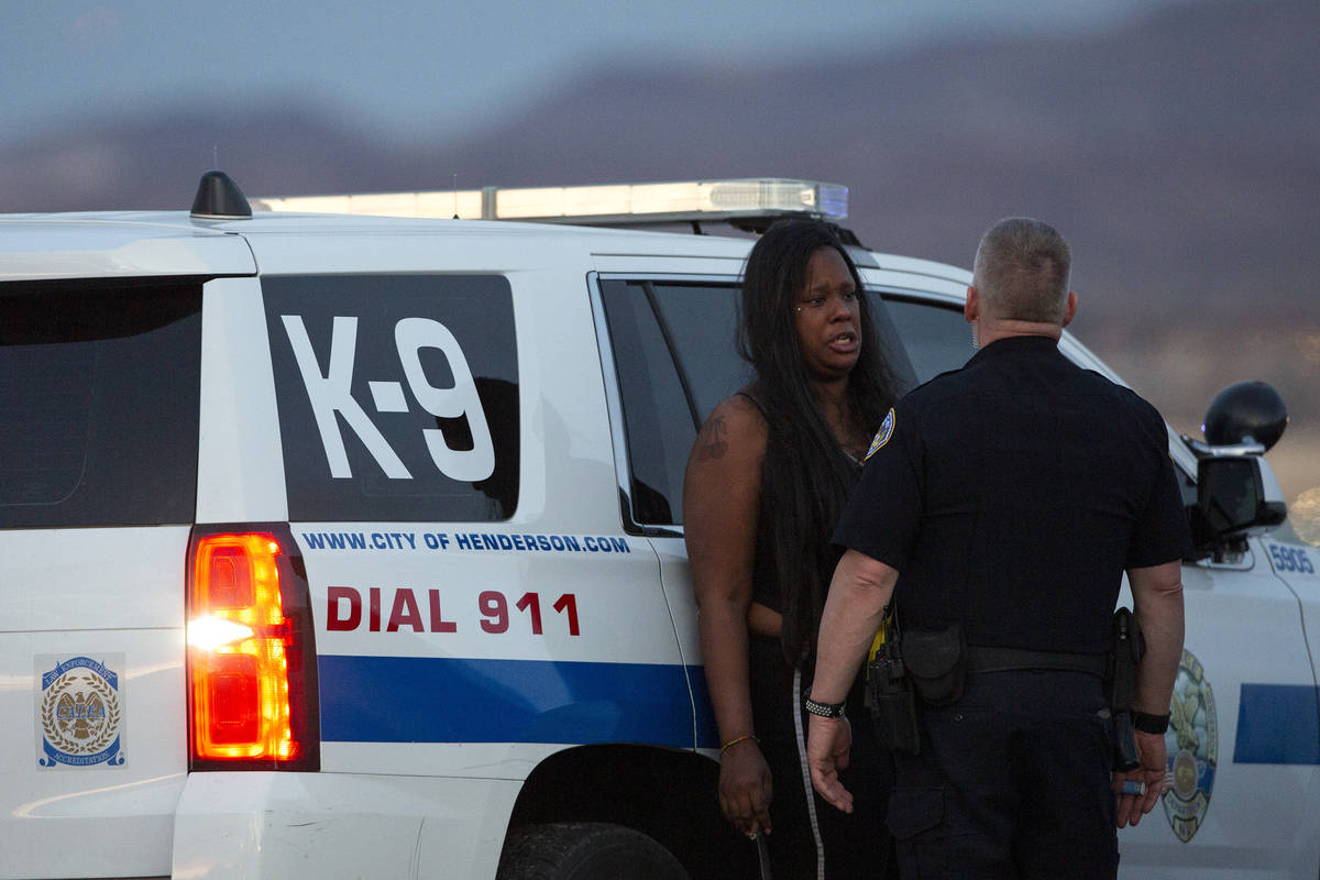 Henderson police speak with Danika Cain while investigating a crime scene at Welpman Way and La ...