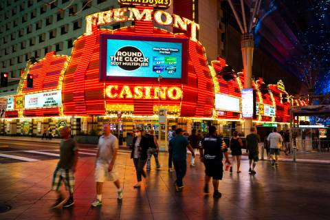 People cross Casino Center Boulevard outside of the Fremont in a June 3, 2020, file photo. (Cha ...