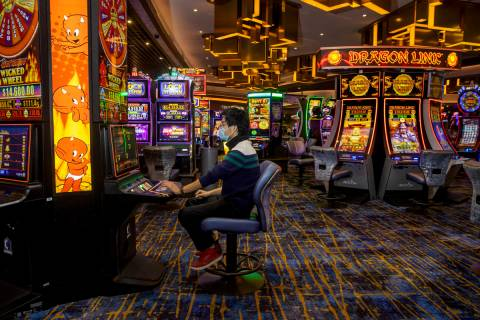 Zaw Naw of Denver plays the Hot Stuff Wicked Wheel slots on the casino floor at the Strat on We ...