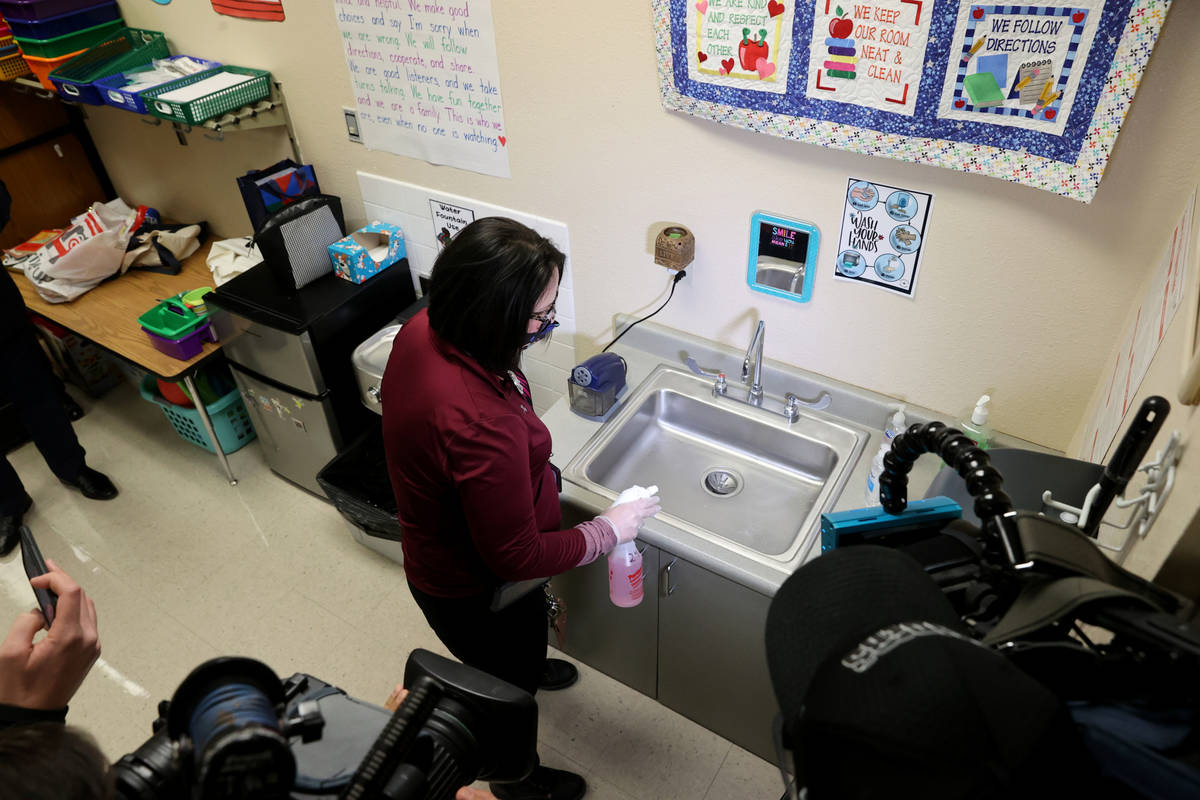 Clark County School District Support Staff Trainer Tia Baker sanitizes a classroom at Eisenberg ...