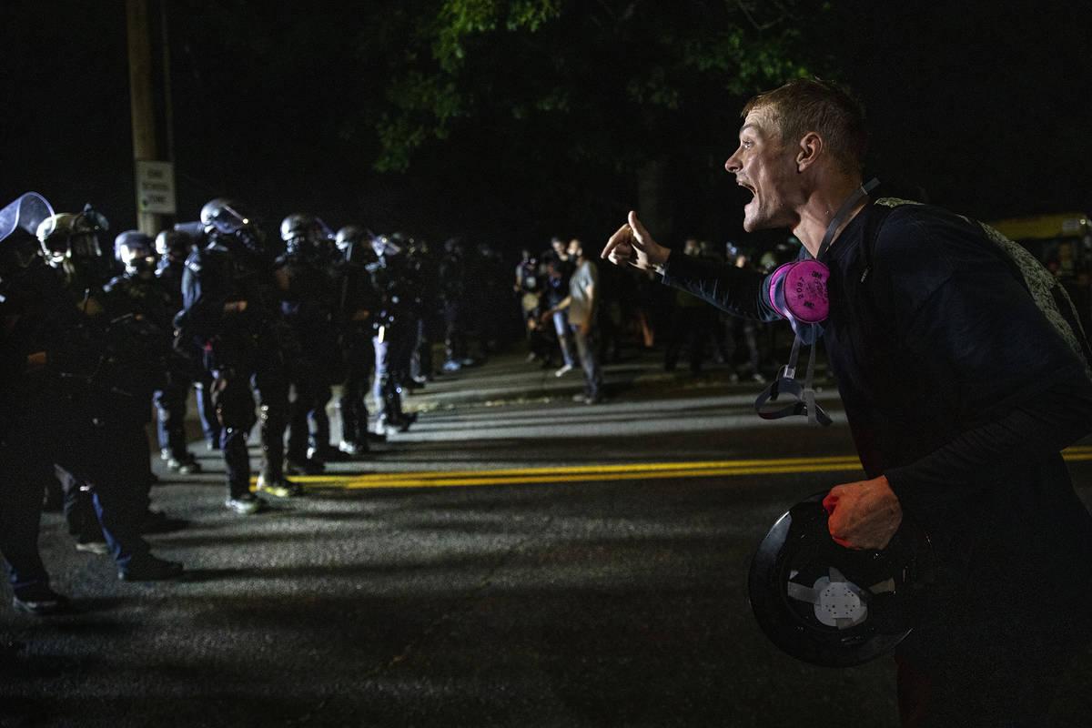 A protester screams at police in Portland, Oregon. (AP Photo/Paula Bronstein)