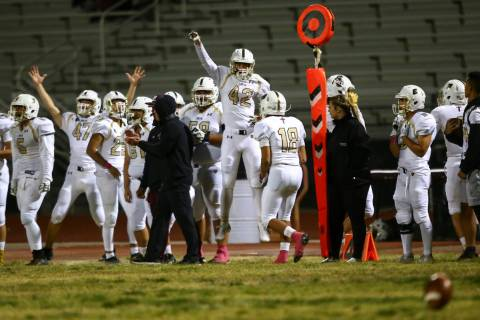 Faith Lutheran players celebrate as they lead during the second half of a football game at Cent ...