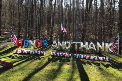 An Honor and Thank balloon setup. The initiative provides a way for people to thank healthcare ...