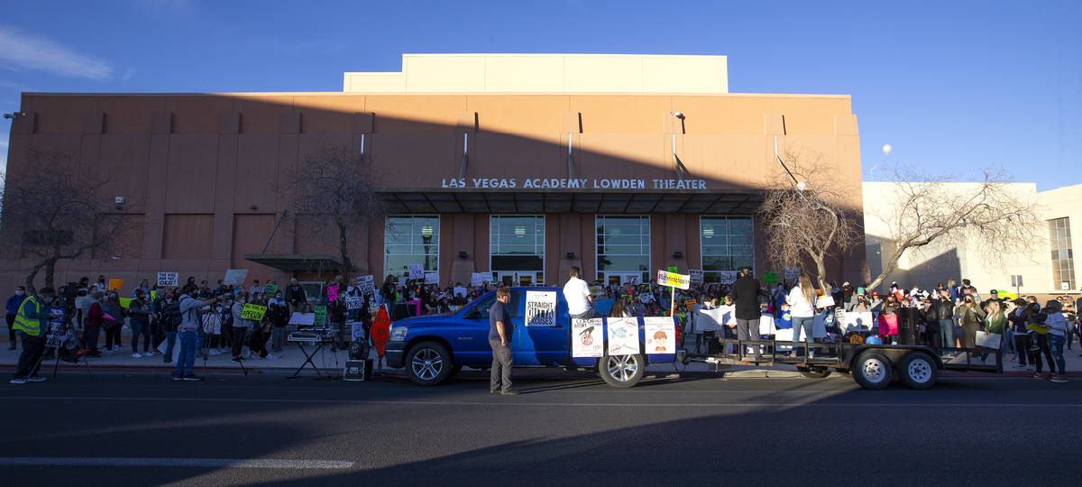 A group of at least 100 people protests outside Las Vegas Academy of the Arts before Clark Coun ...