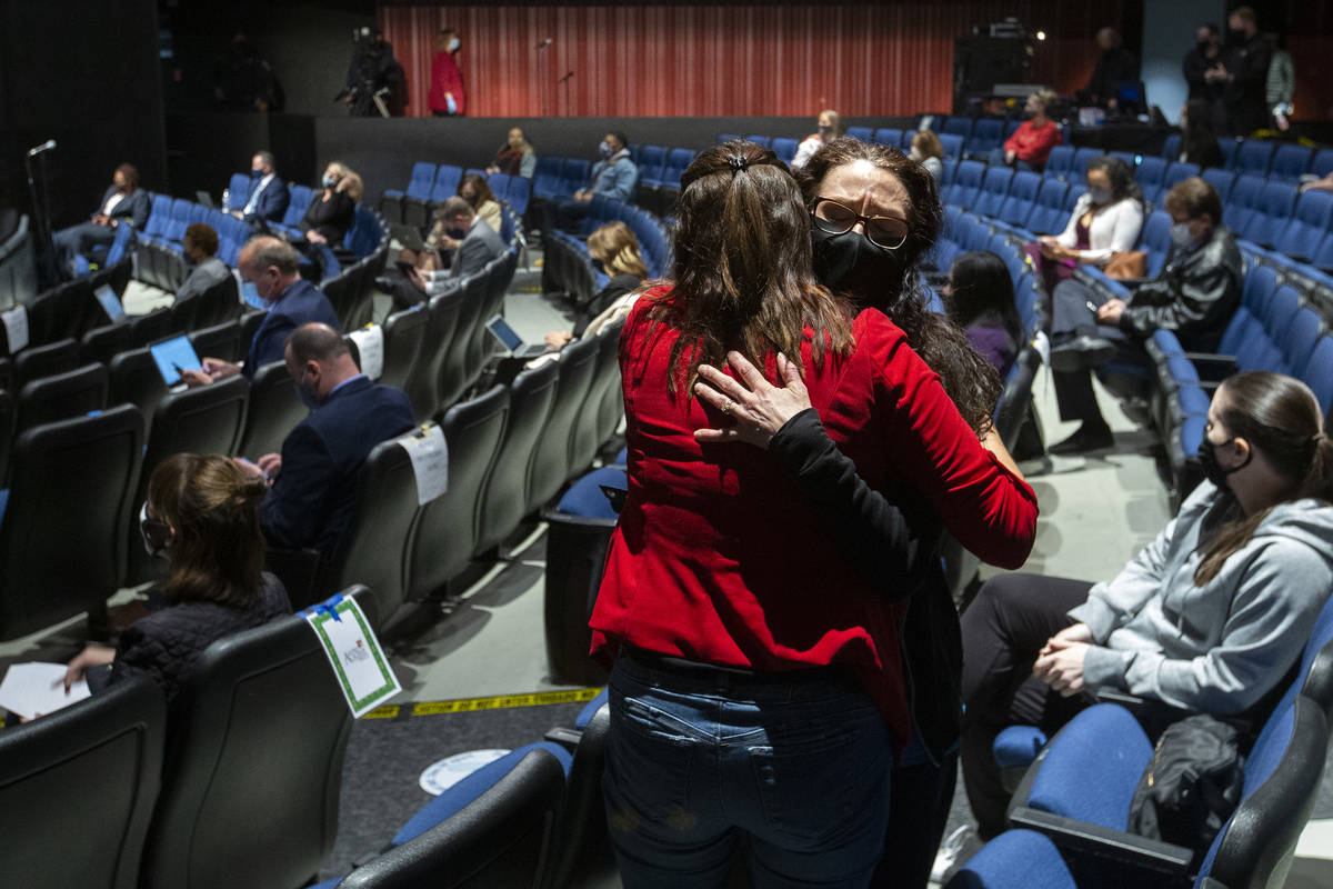 Nicole Goughnour hugs a friend after speaking during the comment period of Clark County School ...