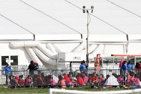 Immigrant children are shown outside a former Job Corps site that houses them in Homestead, Fla ...