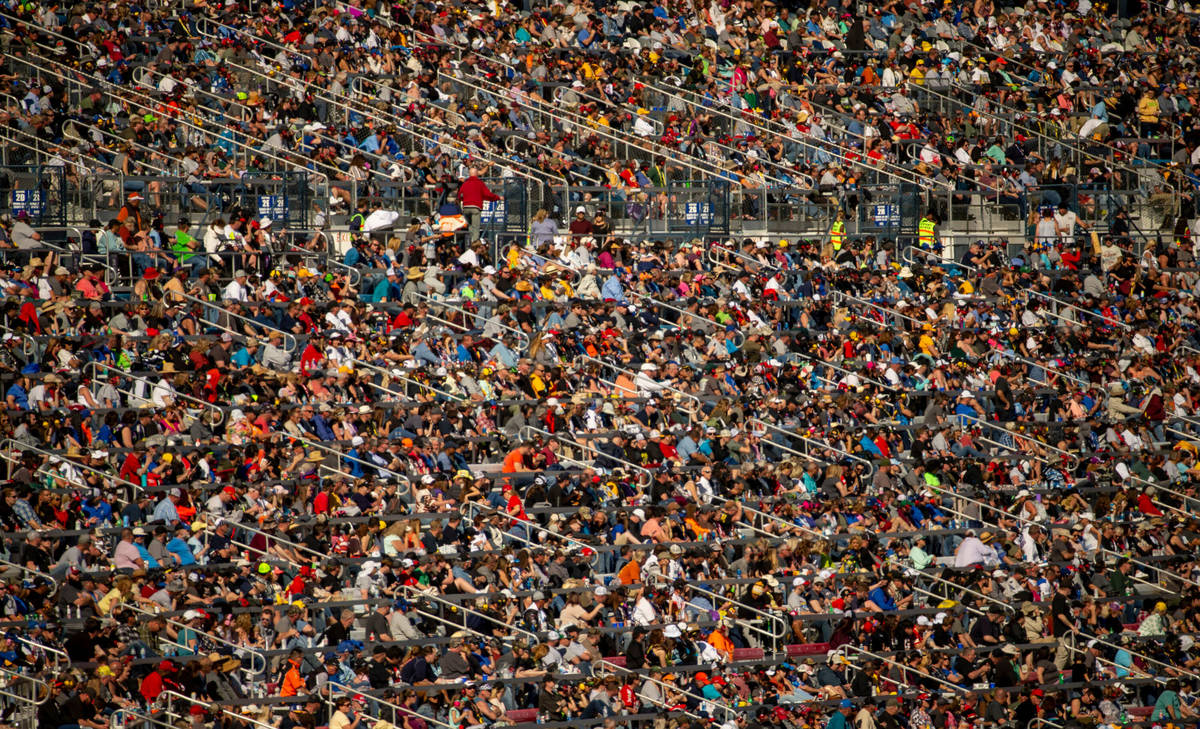 Thousands of fans pack the stands during the Pennzoil 400 presented by Jiffy Lube, a NASCAR Cup ...